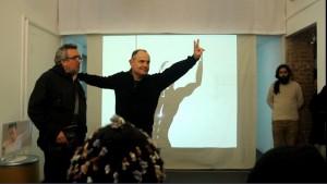 """Foto: da sin. Claudio Elli, Riccardo Magherini . Sullo sfondo, un'immagine comics di Alex Miozzi. """"Aspettando Gebrek"""", Spazio Nour viale Bligny 42 a Milano, martedì 9 dicembre 2014"""